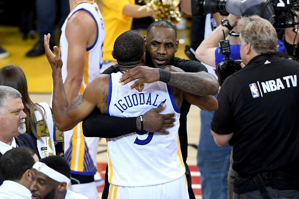 Andre Iguodala of Golden State Warriors hugs LeBron James after Game 5 of the 2017 #NBAFinals