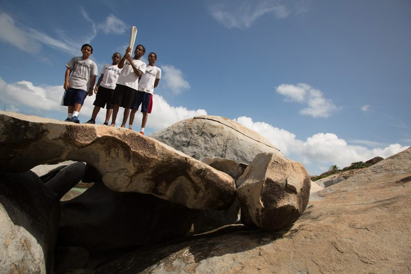 Athletes of the Raw Skills Track Club pose with the Baton at The Baths