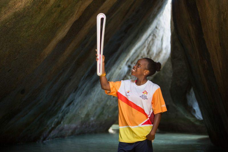 Footballer Jackisha Rigobert holds the Baton at The Baths