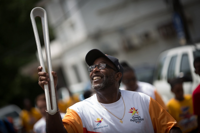Former Olympian Guy Hill carries the Baton