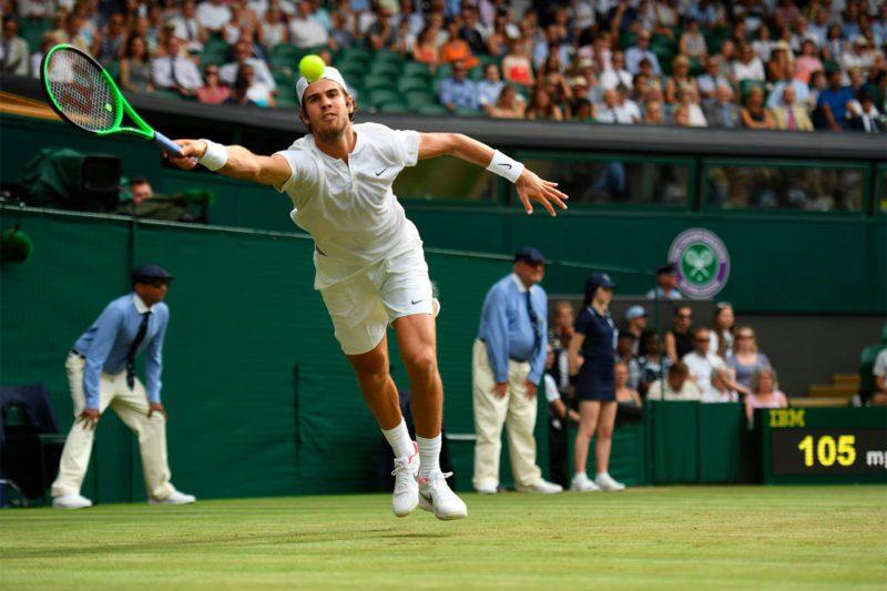 Karen Khachanov dealing with Nadal's power serve
