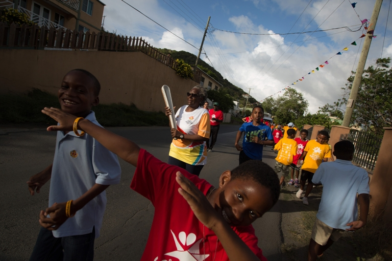 Students from Willard Wheatley Primary School run with the Baton