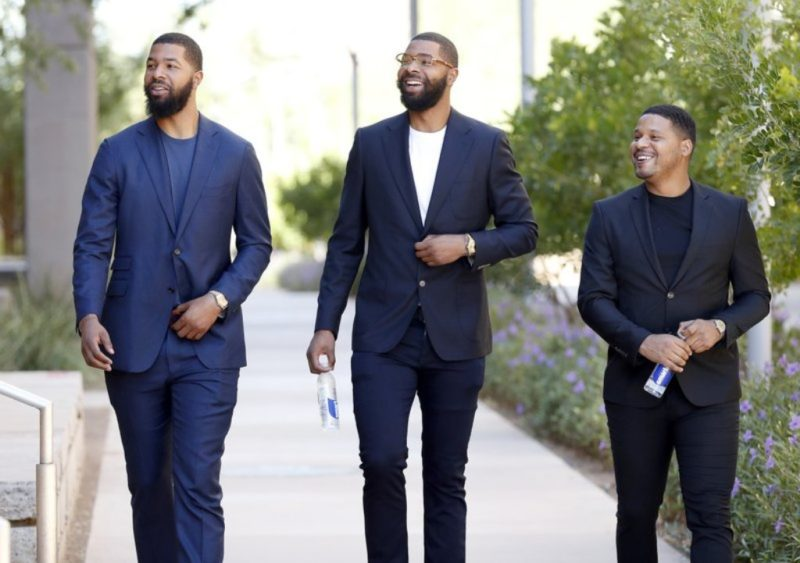 Markieff, left, and Marcus Morris arrive with Gerald Bowman