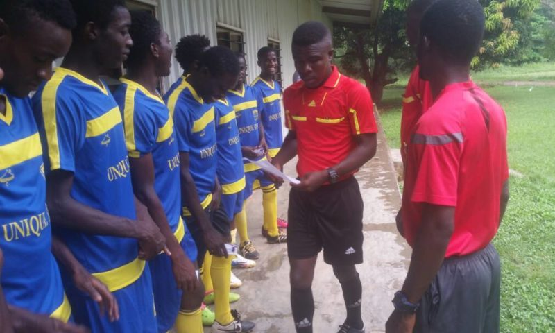Officiating officials inspecting players of Unique Stars before kick off