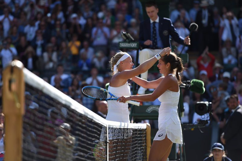 Goerges and Mertens embraces each other