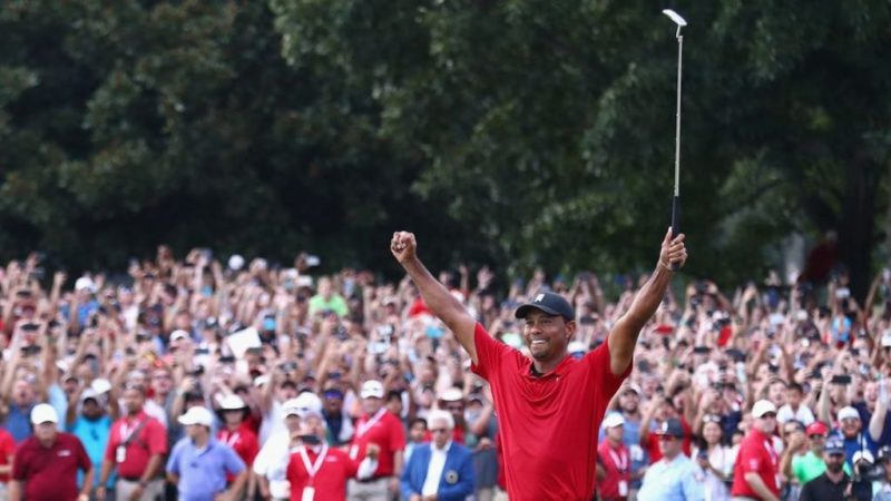Tiger Woods celebrates his first PGA Tour win since 2013